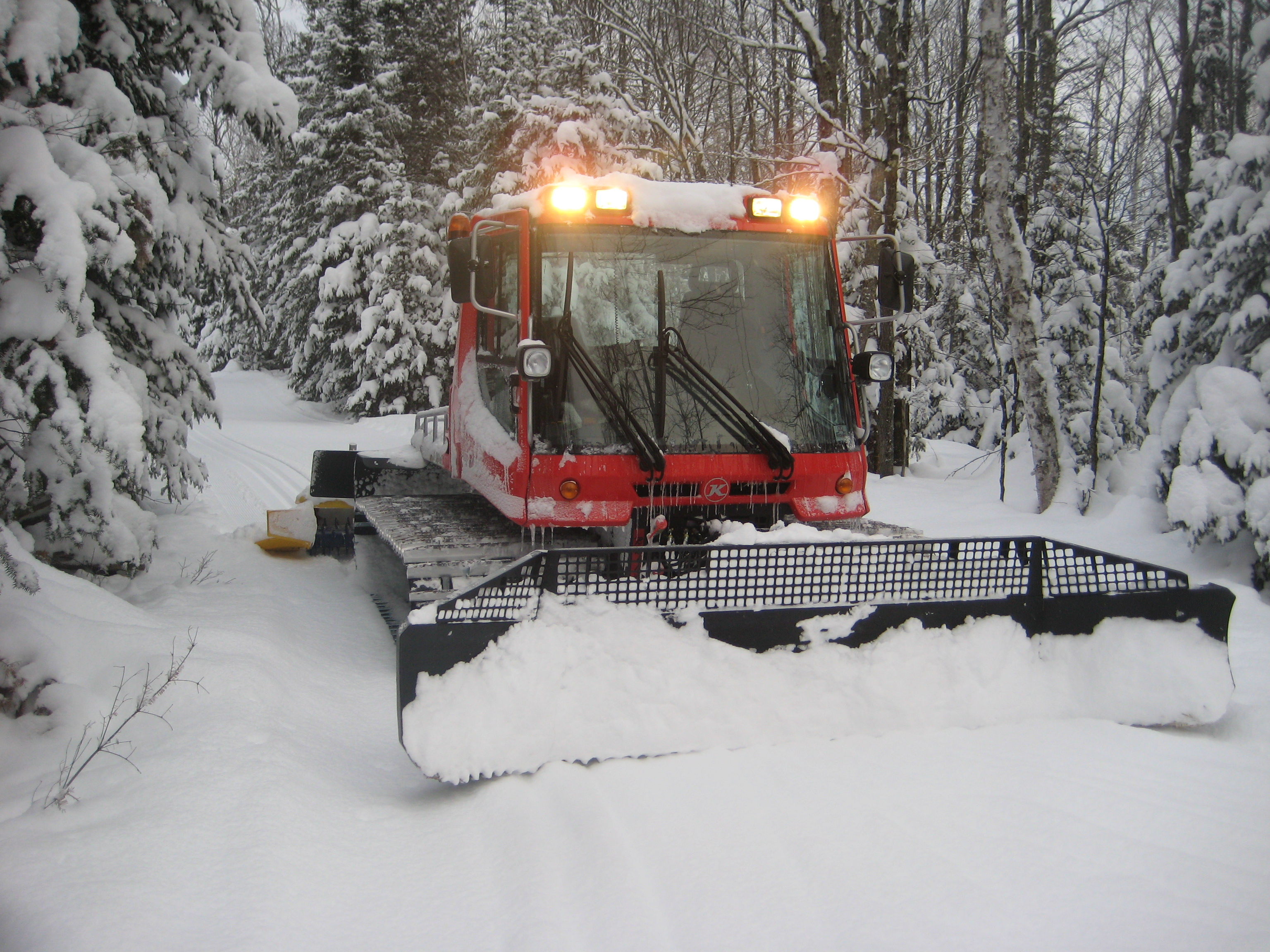 The Pisten Bully doing its magic in Winter Wonderland – ABR Trails