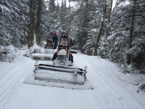 3 of the groomers grooming the snow this morning on River Trail